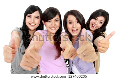 Group of beautiful women showing thumbs up together to camera - stock photo
