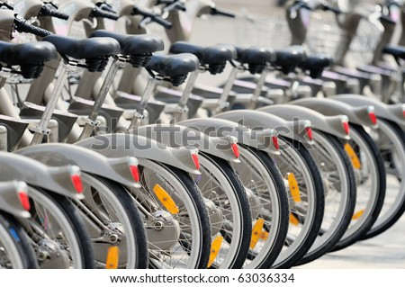 Group of bicycles in the row.  Photo with tilt-shift lens - stock photo