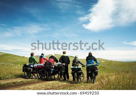 Group of bicyclists going on road. Lake Baikal island Olkhon - stock photo