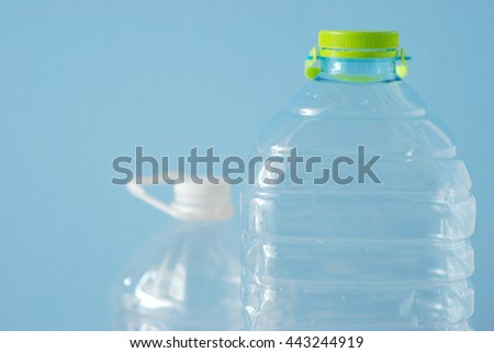 group of big bottles of water on blue background