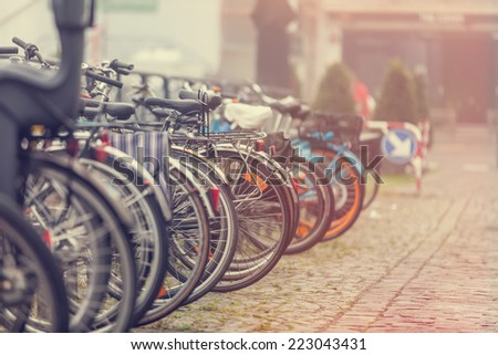 Group of bikes in parking in Amsterdam - stock photo