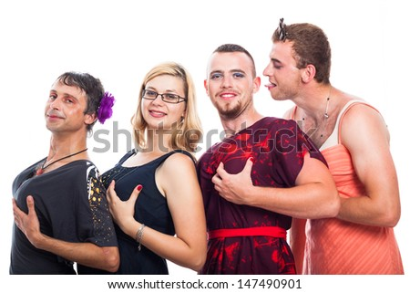 Group of bizarre three men cross-dressing and one woman holding breasts, isolated on white background. - stock photo
