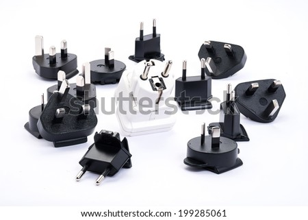 group of black and white universal adapter isolated on white background - stock photo