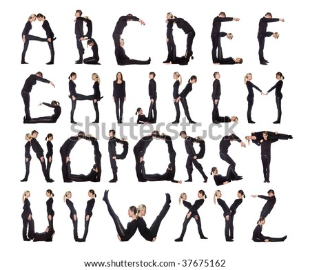 Group of black dressed people forming the alphabet. - stock photo