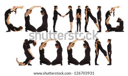 Group of black dressed people standing over white forming COMING SOON words - stock photo