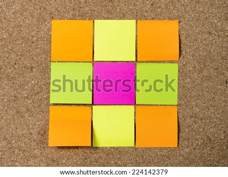 Group of blank Notes in blank as copy space in different colors such as pink, yellow, orange and green on message cork board - stock photo