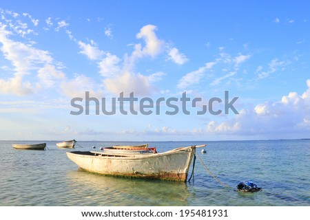 Group of boats floating on calm ocean, Mauritius
