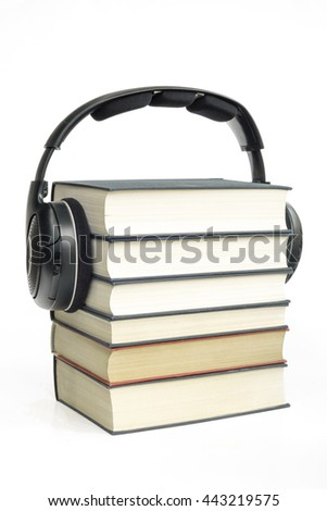 Group of books and headphones related to audiobooks, E-books and digitally listening conversations and storytelling of written books with white isolated background