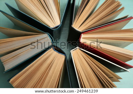 Group of books on colorful background, top view - stock photo