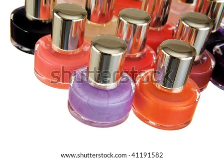 Group of bottles of colour nail polish on a white background