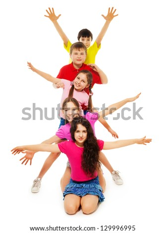 Group of boys and girls sitting in a row waiving hands - stock photo