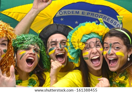 Group of Brazilian soccer fans commemorating victory. - stock photo