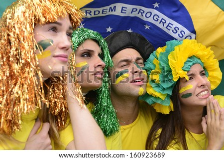 Group of brazilian soccer fans concerned with the performance of the Brazilian national team. - stock photo