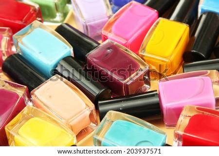 Group of bright nail polishes, close up - stock photo