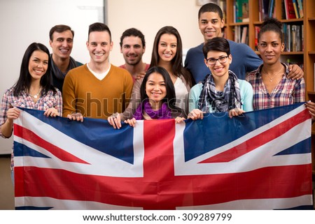 Group of British students presents their country and hold the flag - stock photo