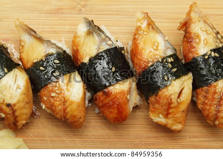 Group of broiled eel (unagi) sushi with sesame seeds - stock photo