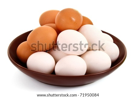Group of brown and white hen's eggs in the plate isolated on white