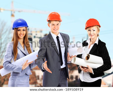 Group of builders workers. Construction industry background.