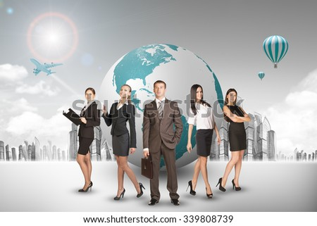 Group of buisnesspeople with earth globe with city background - stock photo