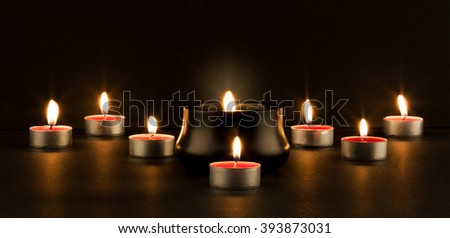 Group of burning candles on black background, shallow depth of field.