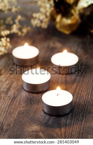 Group of burning candles with focus on a flame - stock photo