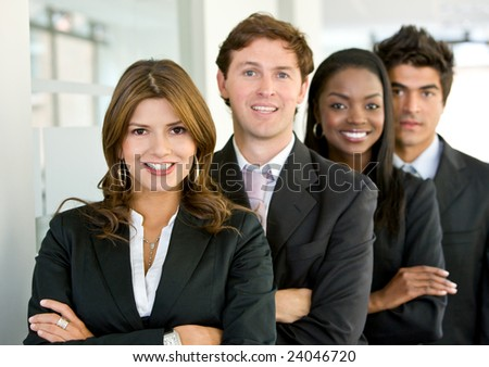 group of business colleagues smiling in an office lined up