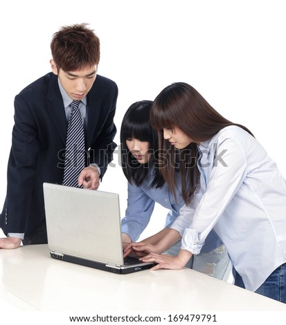 Group of business colleagues working together on a laptop