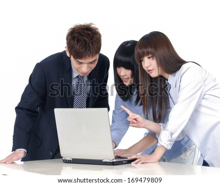 Group of business colleagues working together on a laptop - stock photo