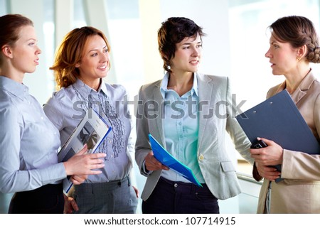 Group of business ladies discussing latest business news