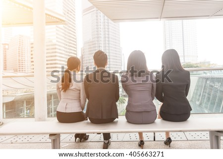 group of business man and woman sit in the outside of office in Hong Kong - stock photo