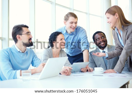 Group of business partners discussing strategies at meeting in office - stock photo