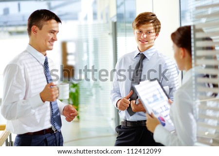 Group of business partners interacting during break - stock photo