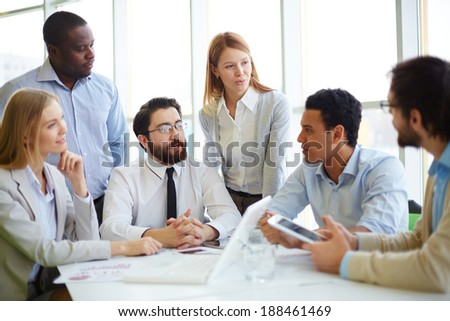 Group of business partners interacting in office