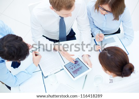 Group of business partners interacting while planning work at meeting