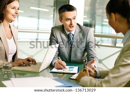 Group of business partners planning work at meeting in office - stock photo