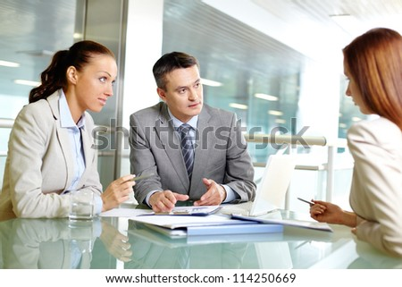 Group of business partners planning workat meeting in office - stock photo
