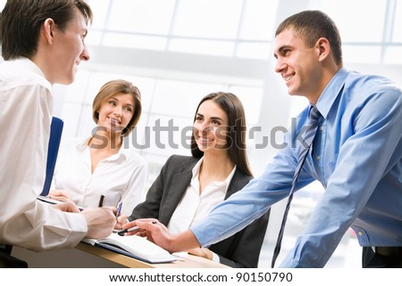 Group of business people analyzing and discussing during a working meeting - stock photo