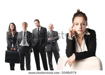 Group of business people and close up to a young businesswoman - stock photo