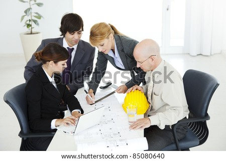group of business people and engineers planning a project - stock photo