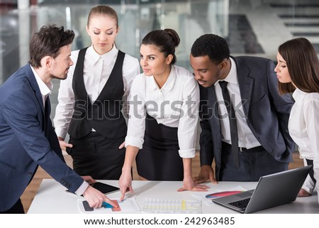 Group of business people are discuss a project, using laptop, tablet. - stock photo