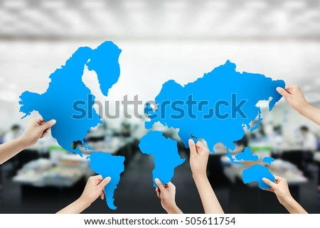 Group business people assembling jigsaw puzzle stock photo royalty group of business people assembling jigsaw puzzle world map and teamwork concept global teamwork gumiabroncs Gallery