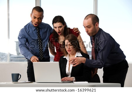 group of business people at an office desk - stock photo