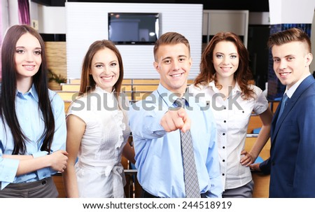 Group of business people at conference hall - stock photo