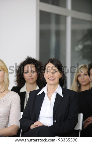 Group of business people at conference listening lecture - stock photo