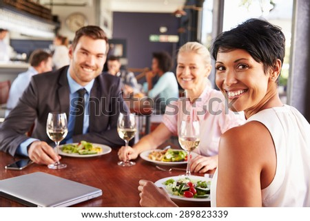 Group of business people at lunch in a restaurant - stock photo