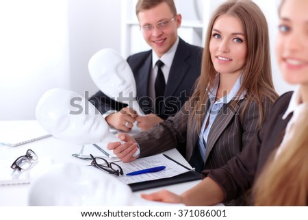 Group of business people  at meeting. Business people hide their emotions under the mask of confidence during the negotiations , business concept - stock photo