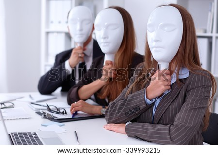 Group of business people  at meeting, hiding the emotions under the mask of confidence during the negotiations - stock photo