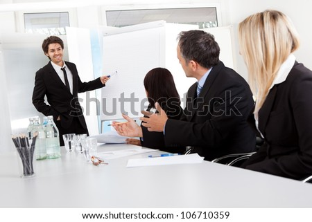 Group of business people at presentation in the office - stock photo