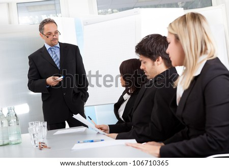 Group of business people at presentation in the office
