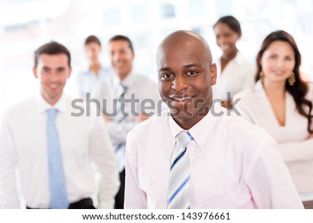 Group of business people at the office looking happy - stock photo
